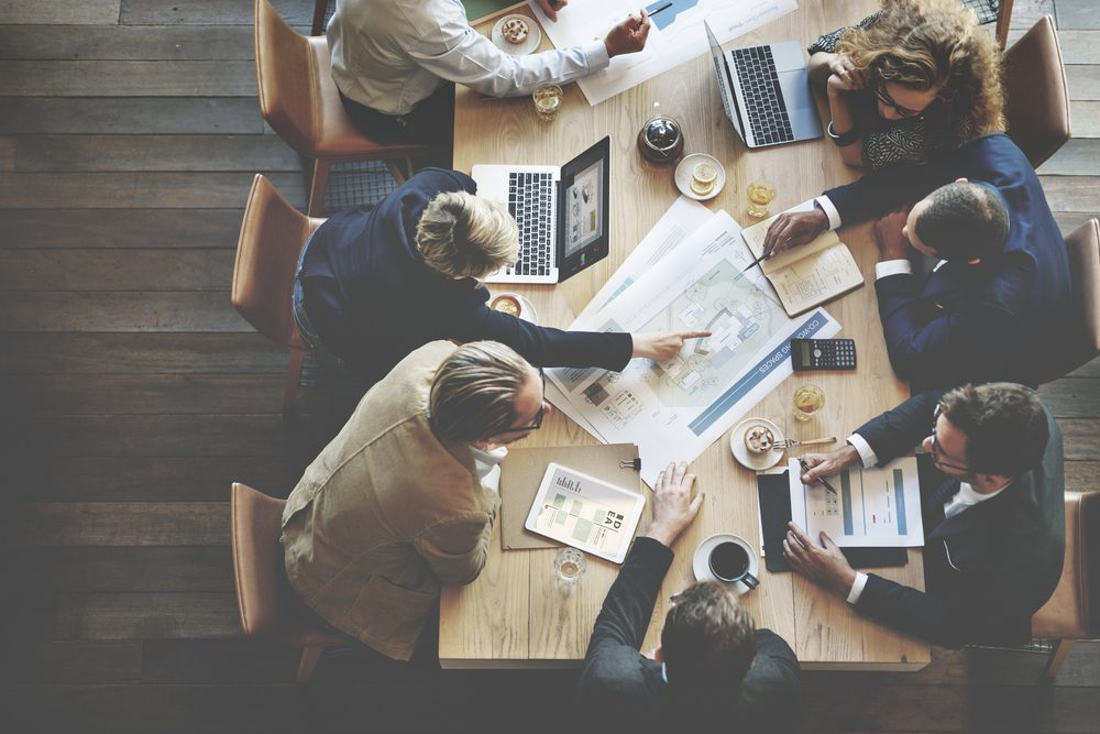 B2B Content marketing strategy - Content marketers planning their content strategy at conference table