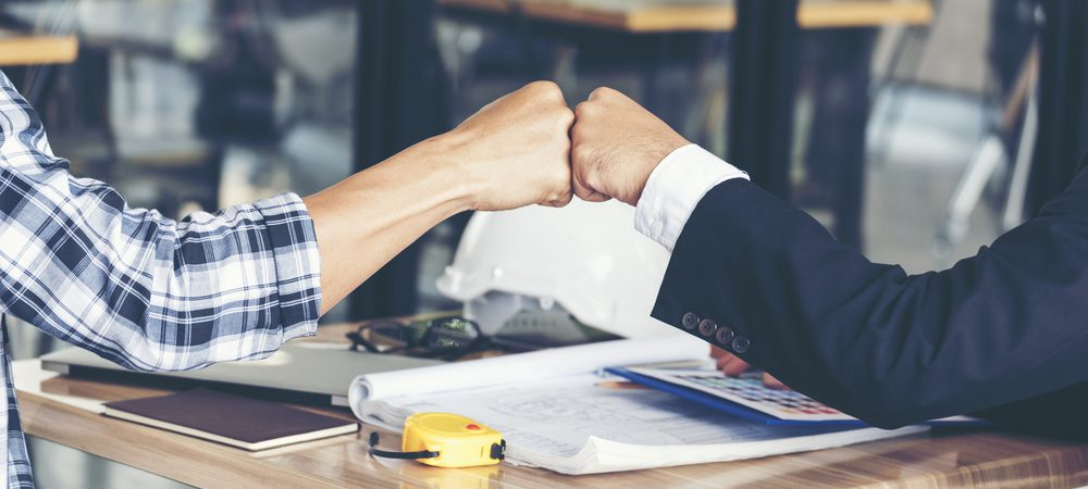 Financial services representative and customer fist bump, positive relationship