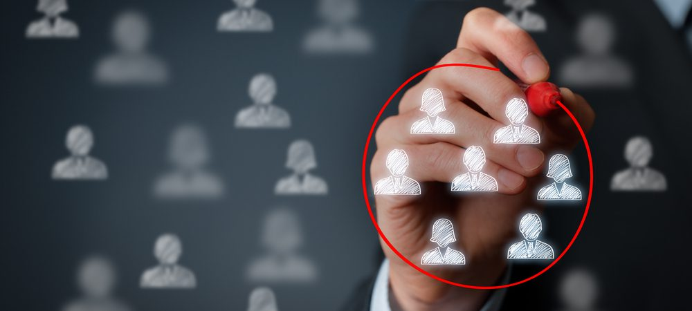 Business man circling a group of people icons in red