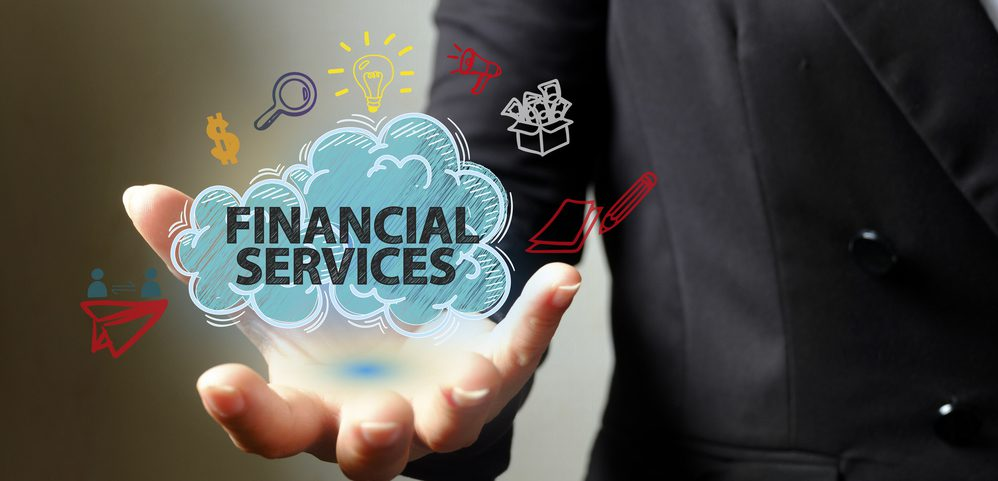 Business man holding a cloud with the words Financial Services inside it