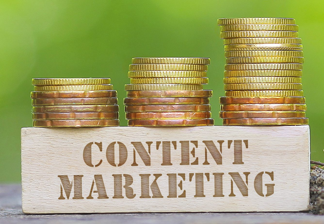 Stashes of gold coins next to a label that says Content Marketing