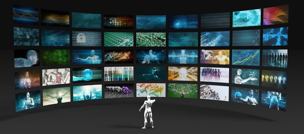 Digitalized depiction of a person looking at a multitude of screens