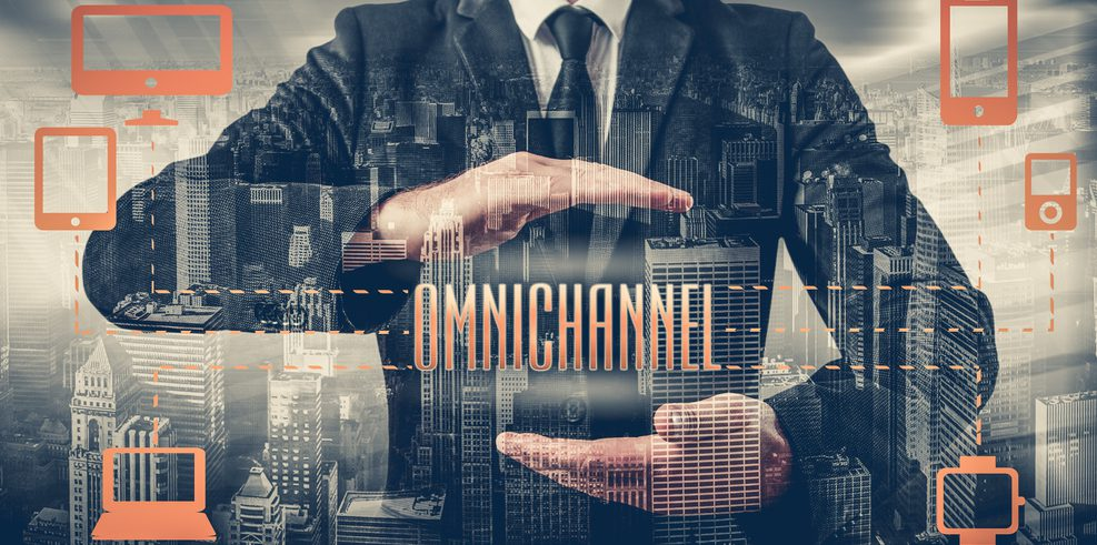 """Business man between his palms the word """"Omnichannel"""""""
