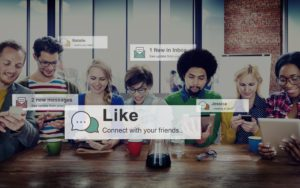 Marketing team using social media with word bubbles showing messages, likes, and shares