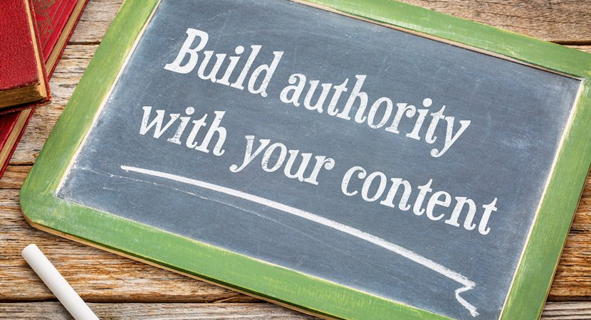 "Chalk board displaying the words ""Build authority with your content"""