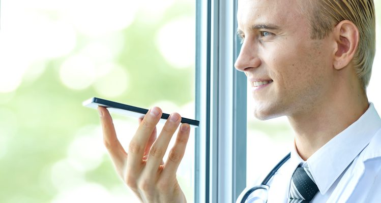A doctor speaking into voice assistant on his mobile phone