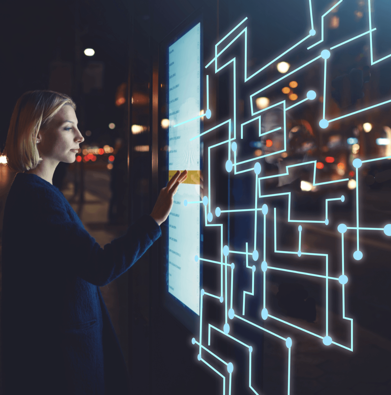 Woman interacting with a high-tech touch screen.
