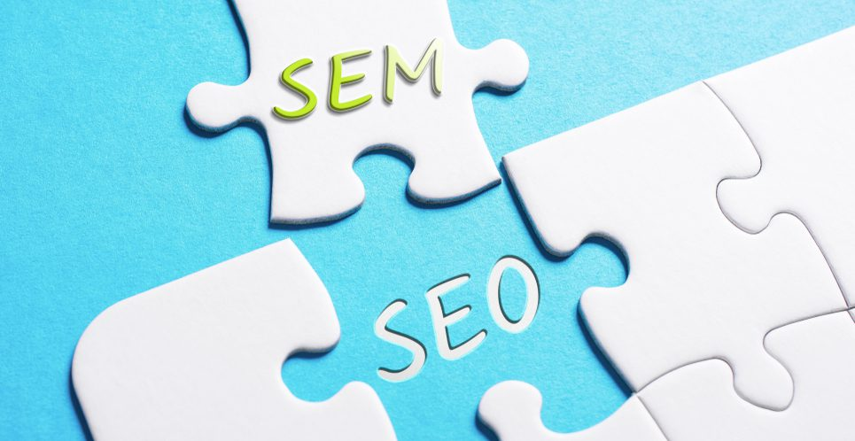 "Puzzle pieces with the words ""SEM"" and ""SEO"" on them."