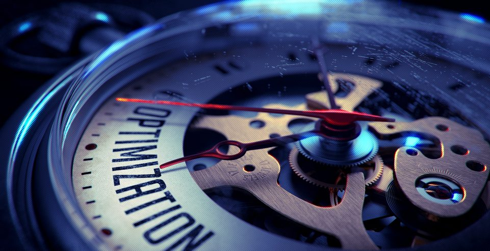 """The inner workings of a clock with the word """"Optimzation"""" in it."""