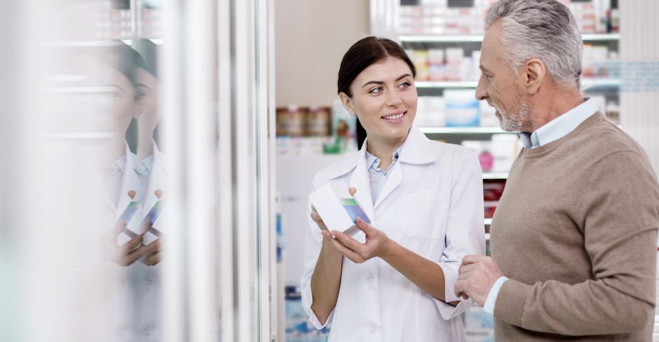 Man and Woman discussing in a pharmacy.