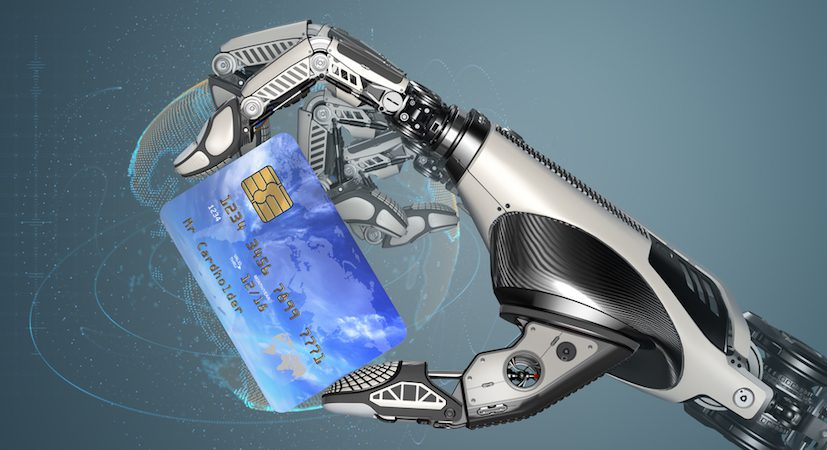Robotic hand holding a credit card.