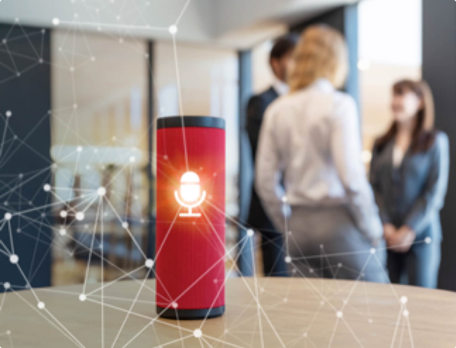 A red smart speaker on a table at work.
