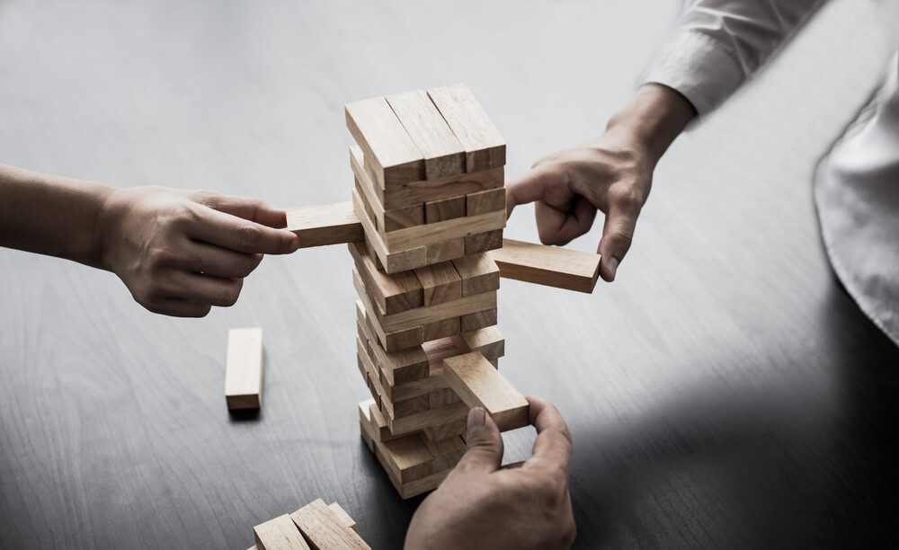 Who needs a Fractional CMO - Business growth with wooden blocks concept.
